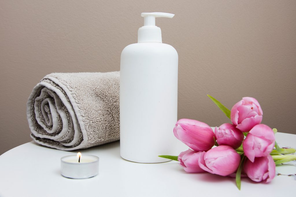 Lotion, towel, and flower for spray tans